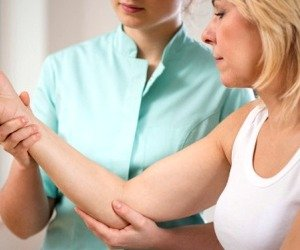 A Physical Therapist Treats a Tennis Elbow patient